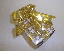 "A Gold ""Christmas Tree"" paper with a Gold Ribbon"